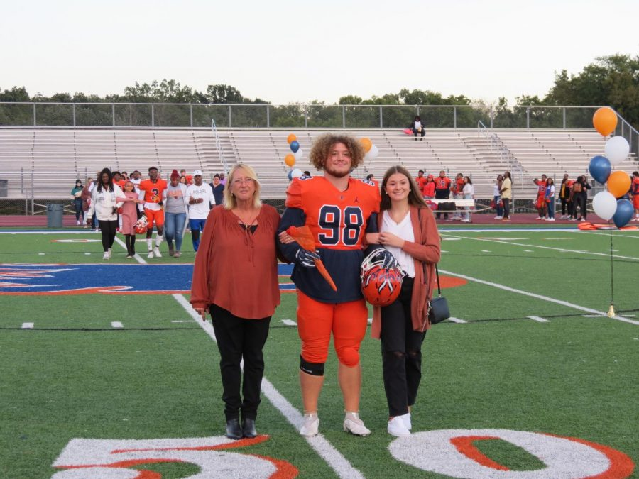 Gage Cool is honored during the Senior Night ceremony before the football game.