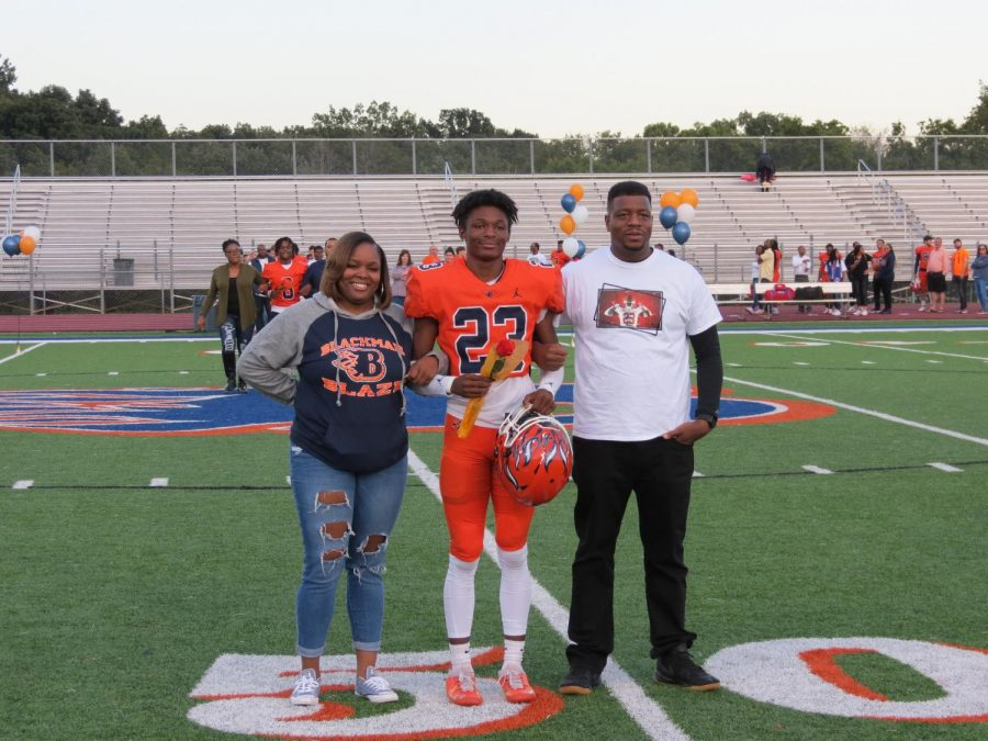 Kyjier Fuller-elmore is honored during the Senior Night ceremony before the football game.