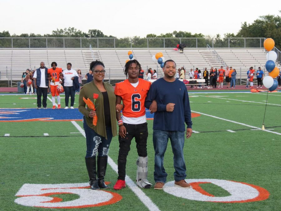 Charles Gaunt is honored during the Senior Night ceremony before the football game.