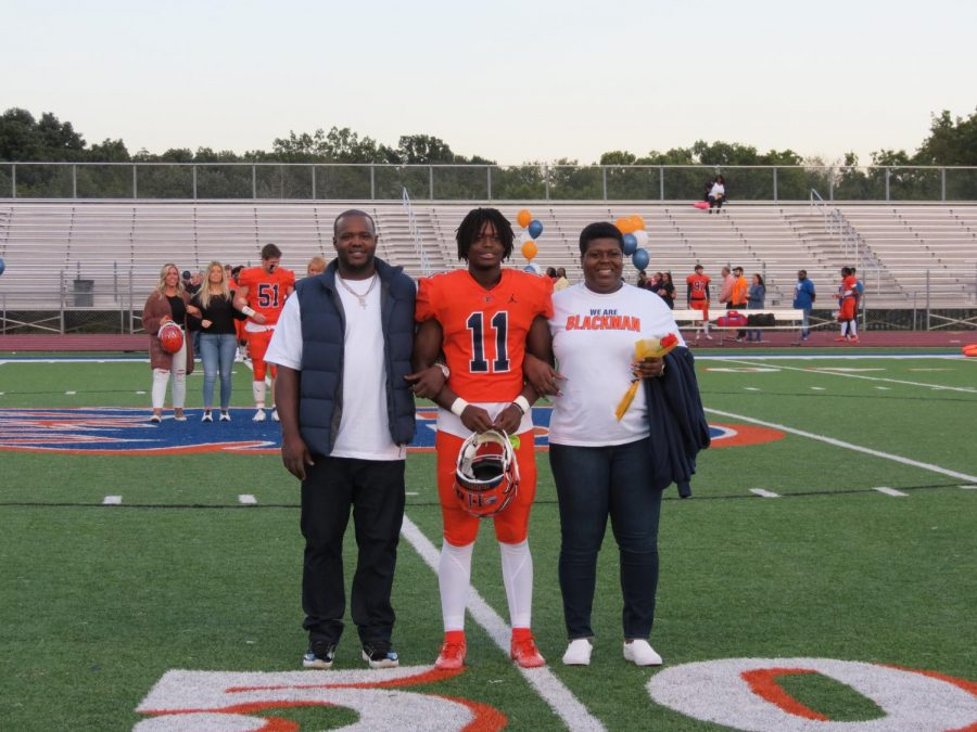 Kayvon Henderson is honored during the Senior Night ceremony before the football game.