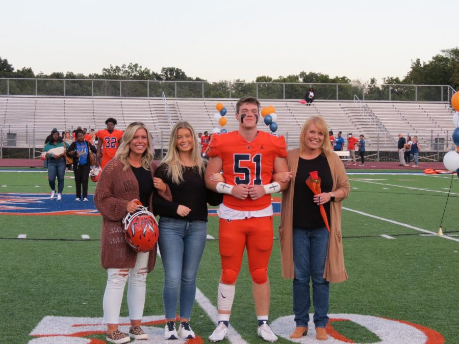 Adam Hickerson is honored during the Senior Night ceremony before the football game.