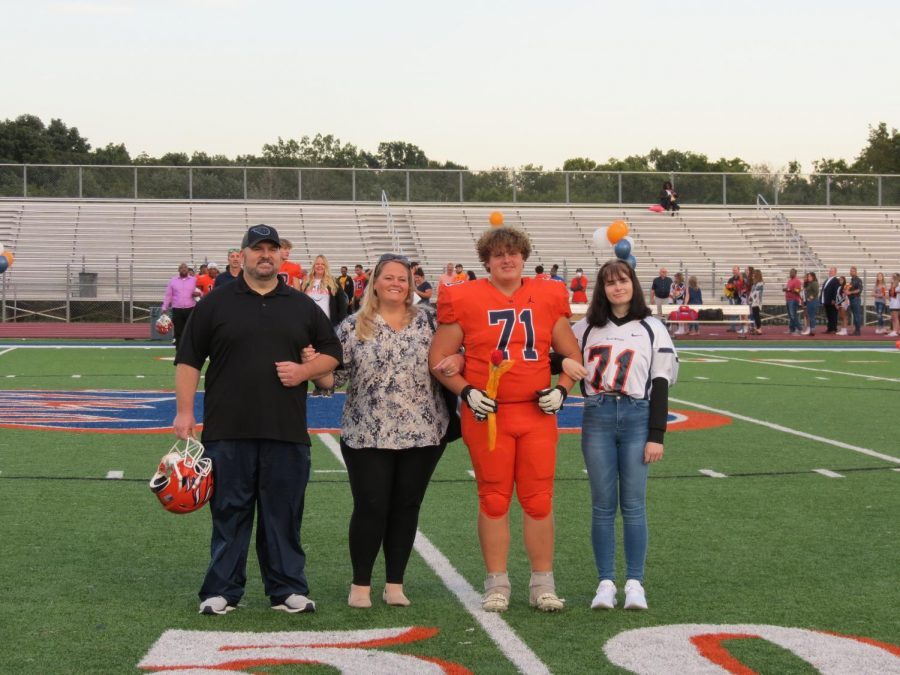 Kyle Millwood is honored during the Senior Night ceremony before the football game.