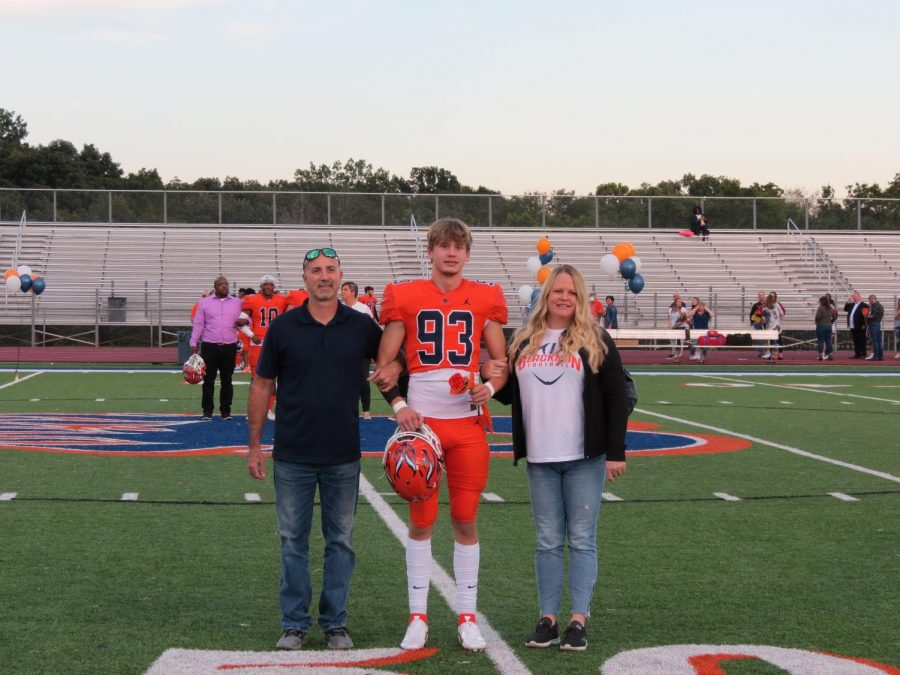 Ethan Murray is honored during the Senior Night ceremony before the football game.