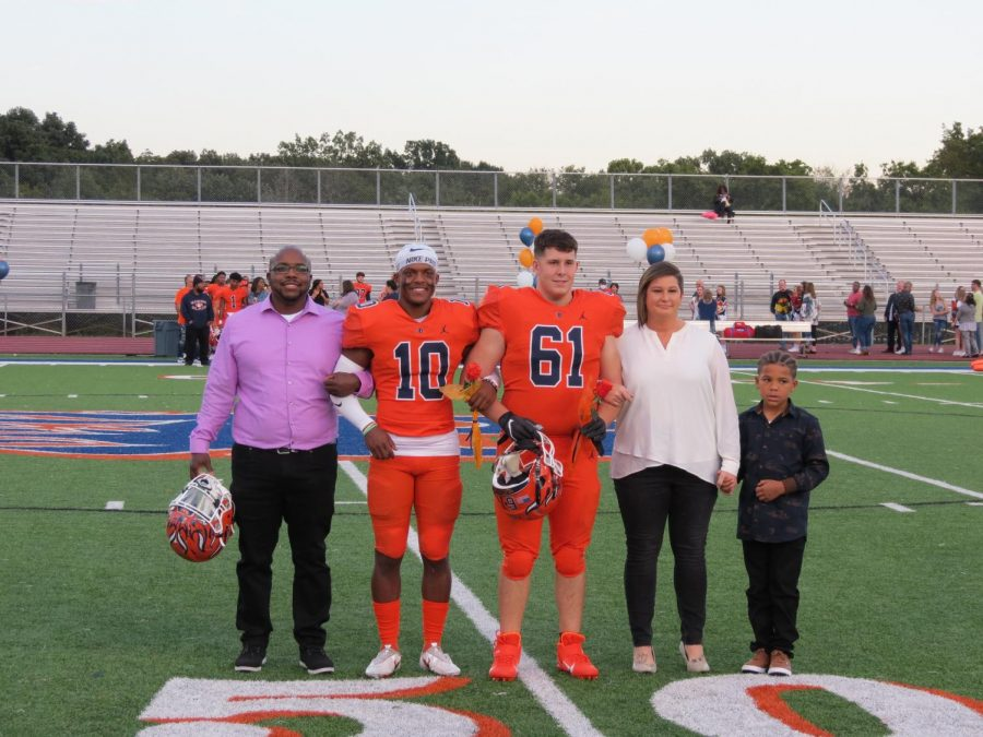 (#61)is honored during the Senior Night ceremony before the football game.