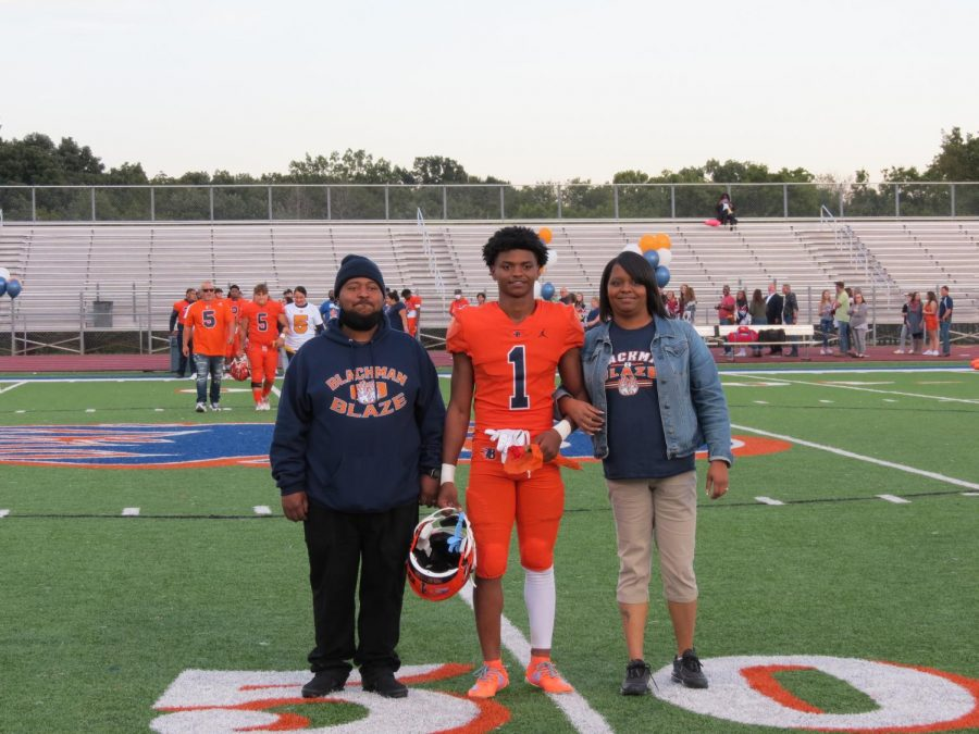 Jaylyn Pleasant is honored during the Senior Night ceremony before the football game.