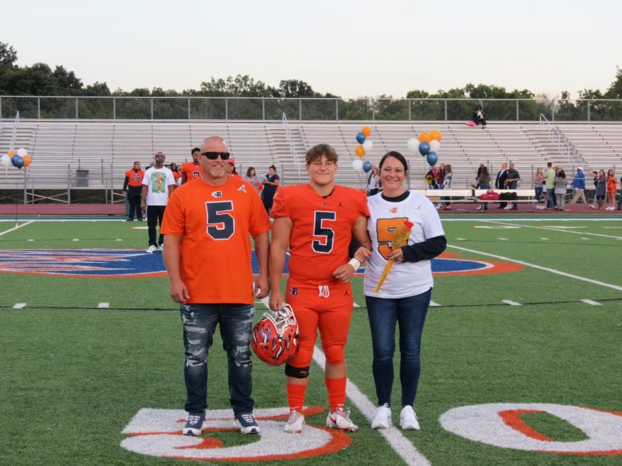 Cole Reed is honored during the Senior Night ceremony before the football game.