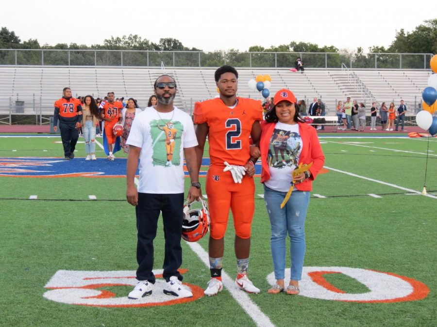 CJ Steele is honored during the Senior Night ceremony before the football game.