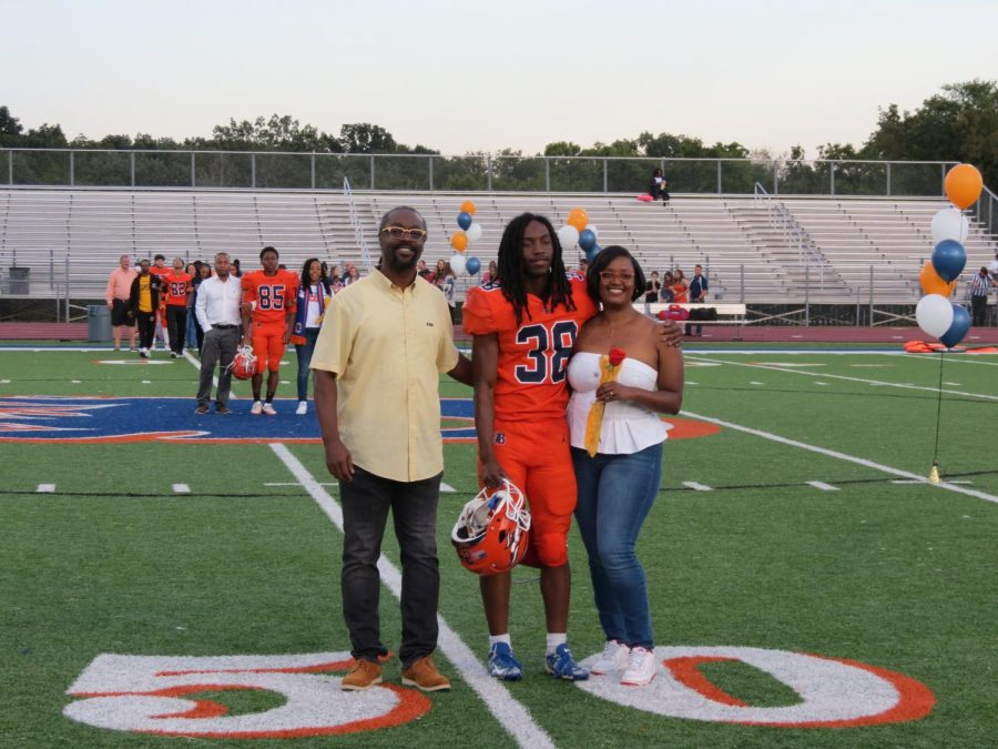 Eugene Thomas is honored during the Senior Night ceremony before the football game.