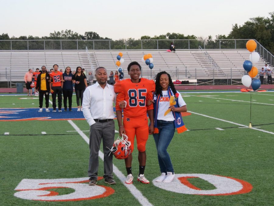 Miles Tory is honored during the Senior Night ceremony before the football game.