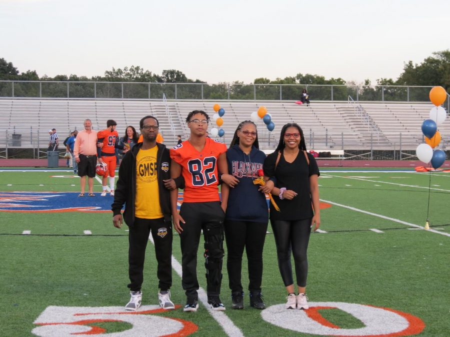 is honored during the Senior Night ceremony before the football game.
