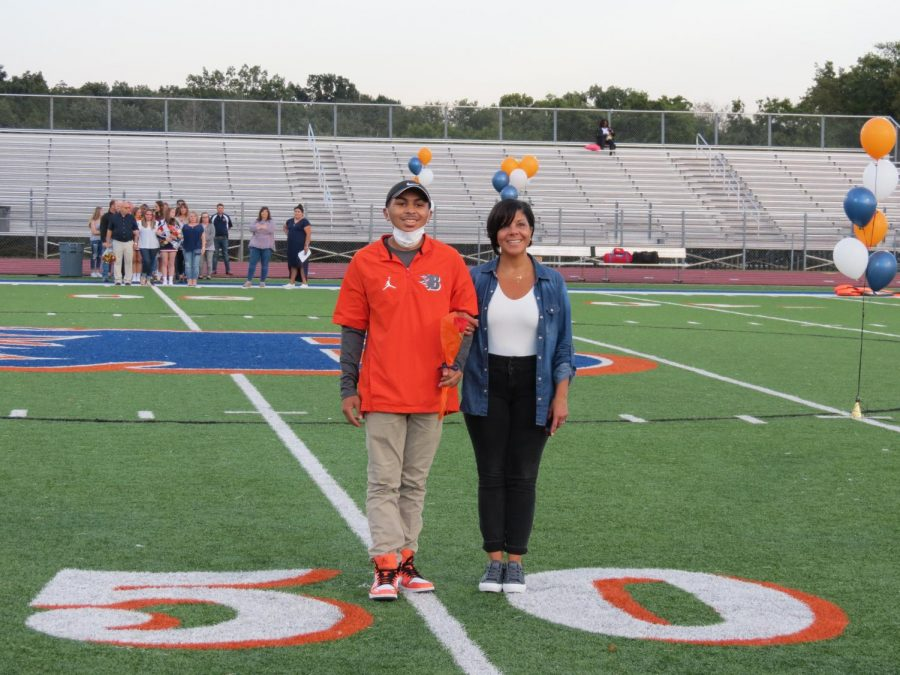 Manager Garrison Gravely is honored during the Senior Night ceremony before the football game.