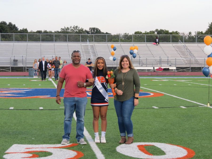 Emma Johnson is honored during the Senior Night ceremony before the football game.