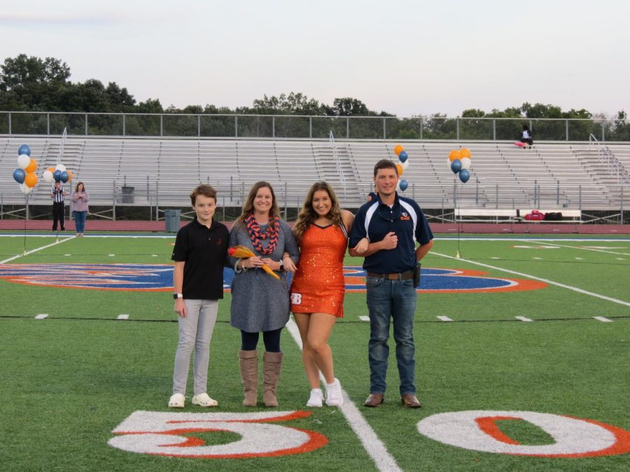 Kiley Scrip is honored during the Senior Night ceremony before the football game.