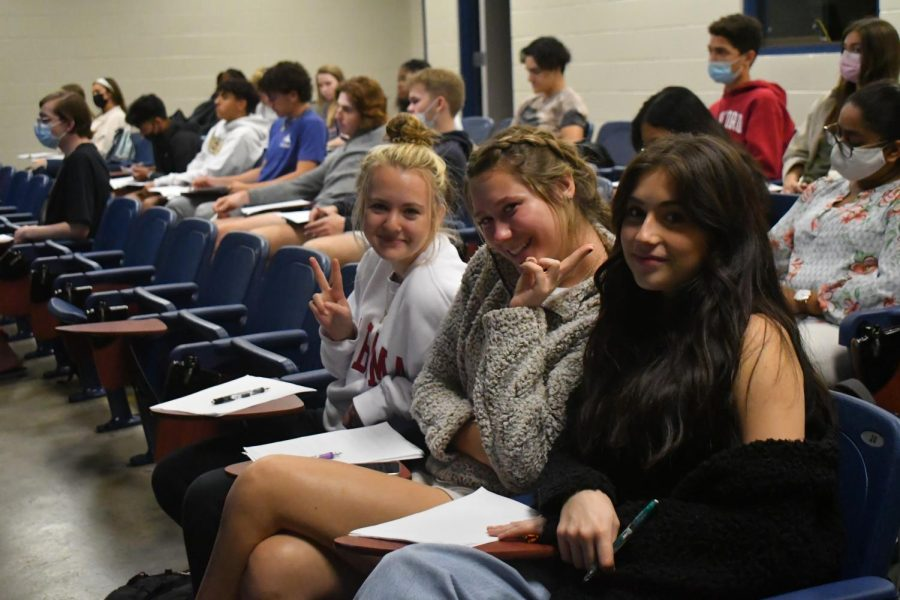 (From left to right) Allyson Colson, Aleah Campbell, and Samira Hernandez (seniors) pose for a photo while studying the OSHA regulations.